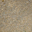 Small stones, gravel, and red dirt — Stock Photo #34000345