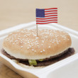 Hamburger with American flag — Stock Photo