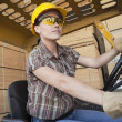 Female industrial worker driving — Stock Photo #34000901