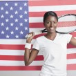 Woman with tennis racket against American flag — Stock Photo #34003065