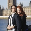 Business couple against Big Ben tower — Stock Photo