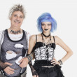 Female punk standing with senior man — Stock Photo