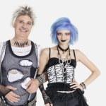 Female punk standing with senior man — Stock Photo