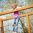 Girl standing at top of rope — Stock Photo