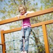 Girl standing at top of rope — Stock Photo #34005559