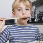 Boy tasting spatula mix — Stock Photo #34005763