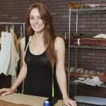 Female dressmaker smiling — Stock Photo #34006151