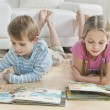 Siblings reading books — Stock Photo #34006645