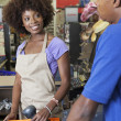 Clerk serving customer — Stock Photo #34007097