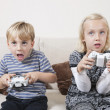 Brother and sister playing video game — Stock Photo #34007305
