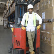 Man standing with fork lift truck — Stock Photo #34007861