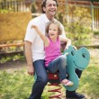Father and daughter on playground — Stock Photo #34008245
