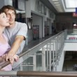 Young couple in shopping centre — Stock Photo #34008989