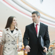 Businessman and businesswoman walking together — Stock Photo