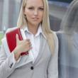 Businesswoman holding organizer — Stock Photo #34009481