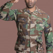 African American US Marine Corps soldier saluting — Stock Photo #34009579