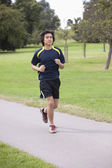 Chinese man jogging at park — Foto de Stock