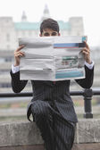 Businessman holding newspaper — Stock Photo