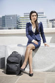 Indian businesswoman with luggage — Stok fotoğraf
