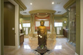 Bathroom with buddha statue — Stock Photo