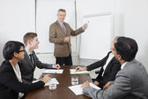 Man using whiteboard in meeting — Stock Photo