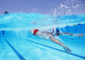 Male athlete swimming in pool — Stock Photo