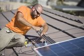 Man working on solar panelling — Stock Photo
