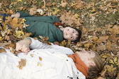 Couple lying on leaves — Stock Photo