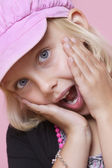 Surprise young girl with hands on face — Stock Photo
