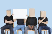 Man holding blank cardboard with friends — Stock Photo