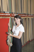 Businesswoman holding thin veneer sheet — Stock Photo