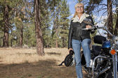 Senior woman poses with motorcycle — Stock Photo