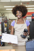 Female store clerk — Stock Photo