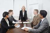 Multiethnic businesspeople at meeting — Stock Photo