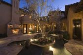 Lit Palm Springs courtyard with pool — Stok fotoğraf