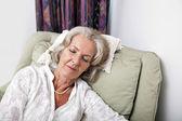 Woman sleeping on armchair — Stock Photo