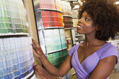 Woman looking at paint swatches — Stock Photo