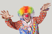 Funny clown with arms raised — Stok fotoğraf