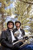 Senior couple next to motorcycle — Stock Photo