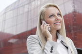 Businesswoman conversing on cell phone — Stock Photo