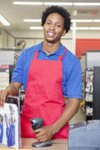 Clerk at checkout counter — Stock Photo