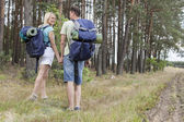 Hiking couple holding hands — Stock Photo