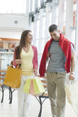 Couple with shopping bags in mall — Stock Photo