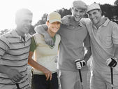 Young friends at golf course — Stockfoto