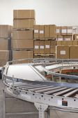 Boxes and conveyor belt — Stockfoto