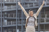 Businesswoman with arms raised — Stock Photo