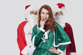 Men in Santa costume standing with woman — Stock Photo