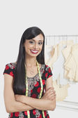 Indian female tailor standing arms crossed — Stock Photo