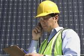 Maintenance worker with photovoltaic array — Stock Photo