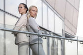 Businesswomen standing back to back — Stock Photo